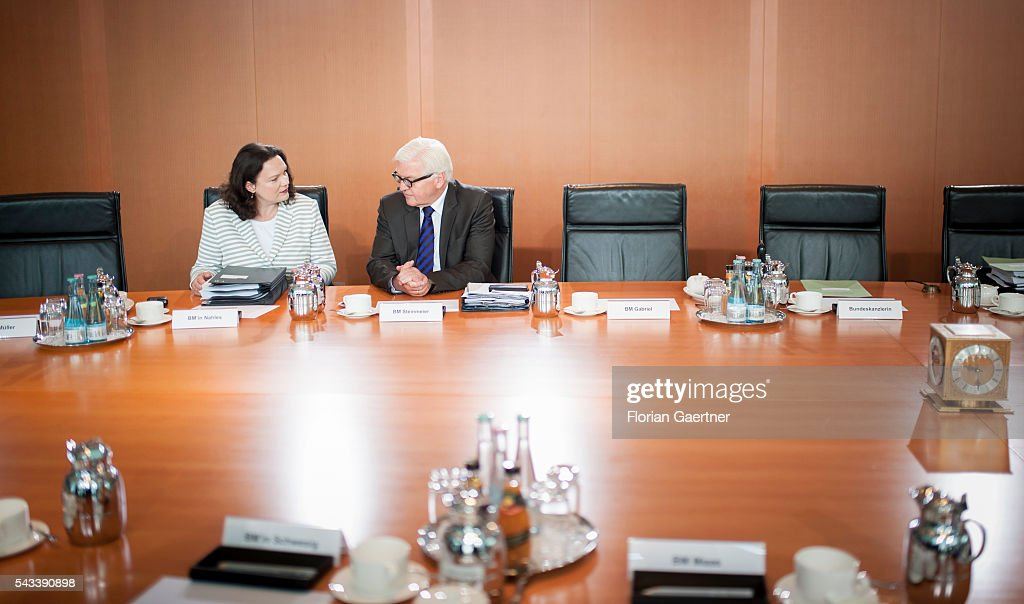German Foreign Minister Frank-Walter Steinmeier (R) talks with German Minister of Work and Social Issues Andrea Nahles (L) before the weekly cabinet meeting at the chancellery (Bundeskanzleramt) on June 28, 2016 in Berlin, Germany.
