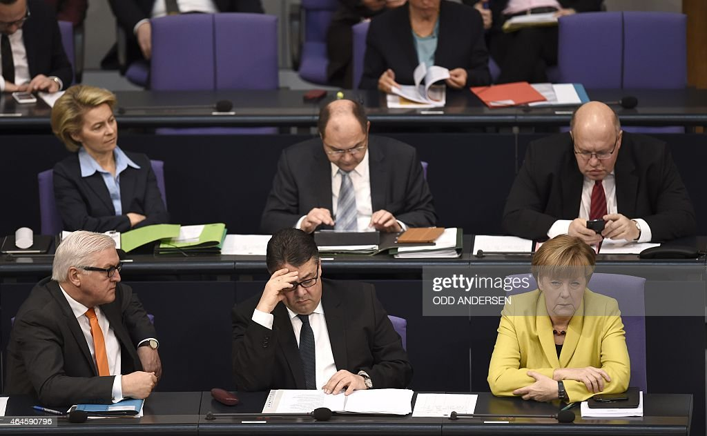 German Foreign Minister FrankWalter Steinmeier Vice Chancellor Economy and Energy Minister Sigmar Gabriel and German Chancellor Angela Merkel sit on...