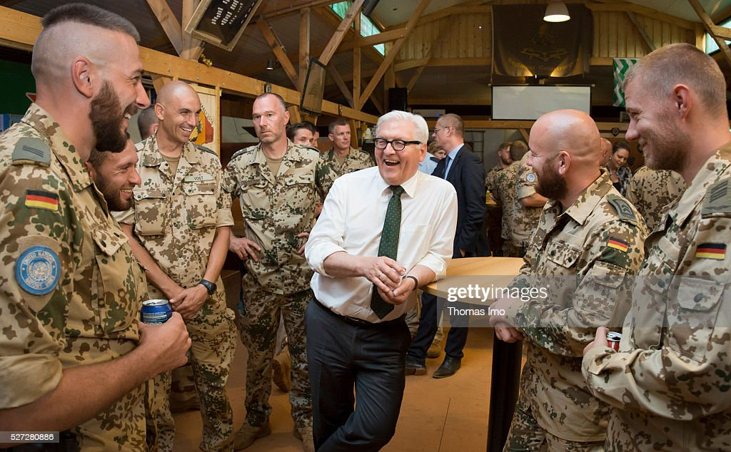 German Foreign Minister <a gi-track='captionPersonalityLinkClicked' href=/galleries/search?phrase=Frank-Walter+Steinmeier&family=editorial&specificpeople=603500 ng-click='$event.stopPropagation()'>Frank-Walter Steinmeier</a> visits soldiers in Camp Castor on May 02, 2016 in Gao, Mali. Steinmeier and French Foreign Minister Marc Ayrault (not pictured) visit Mali and Niger for political conversations.