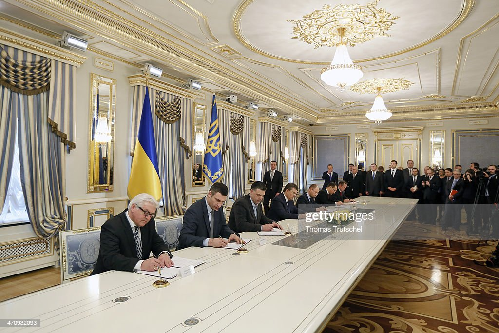 German Foreign Minister Frank-Walter Steinmeier, Vitali Klitschko, leader of Ukraine's UDAR opposition party, leader of All-Ukrainian Union 'Svoboda' Olej Tjahnybok, Ukrainian President Viktor Yanukovych, leader of All-Ukrainian Union 'Fatherland' Arseni Jazenjuk and Polish Foreign Minister Radoslaw Sikorski after the signing of the Agreement in the Presidential Palace on February 21, 2014 in Kiev, Ukraine. Steinmeier and his counterparts from France and Poland meet with President Yanukovych and other government officials and hold separate talks with the opposition. The three ministers will then fly to Brussels for a crisis meeting with EU foreign policy chief Catherine Ashton and other EU foreign ministers.