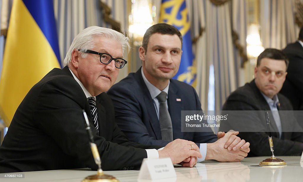German Foreign Minister Frank-Walter Steinmeier, Vitali Klitschko, leader of Ukraine's UDAR opposition party, leader of All-Ukrainian Union 'Svoboda' Olej Tjahnybok, after the signing of the Agreement in the Presidential Palace on February 21, 2014 in Kiev, Ukraine. Steinmeier and his counterparts from France and Poland meet with President Yanukovych and other government officials and hold separate talks with the opposition. The three ministers will then fly to Brussels for a crisis meeting with EU foreign policy chief Catherine Ashton and other EU foreign ministers.