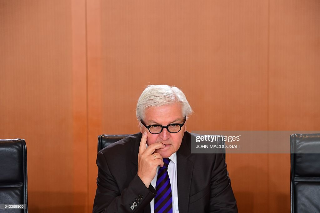 German Foreign Minister Frank-Walter Steinmeier waits before the German government cabinet meeting at the chancellery in Berlin on June 28, 2016. / AFP / John MACDOUGALL