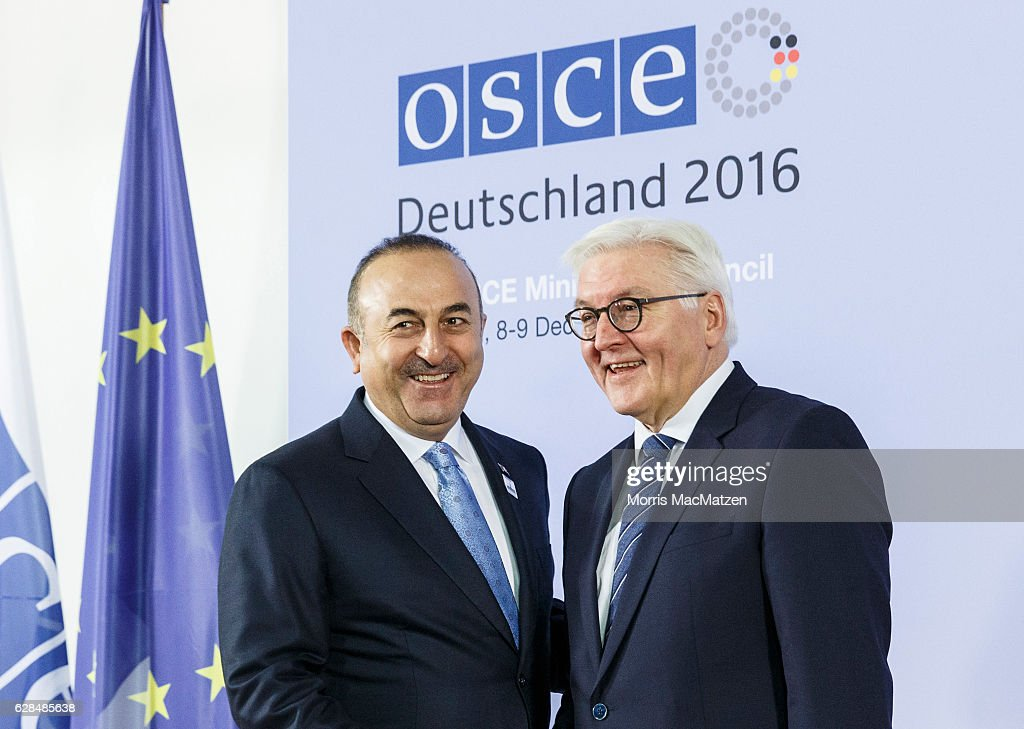 German Foreign Minister Frank-Walter Steinmeier welcomes Turkish Foreign Minister Mevluet Cavusoglu as he arrives for the summit of OCSE members states on December 8, 2016 in Hamburg, Germany. Foreign ministers and other representatives of the 57 member states of the Organization for Security and Cooperation in Europe are meeting for a two-day summit to meet over the ongoing war in eastern Ukraine and the fight against international terrorism.
