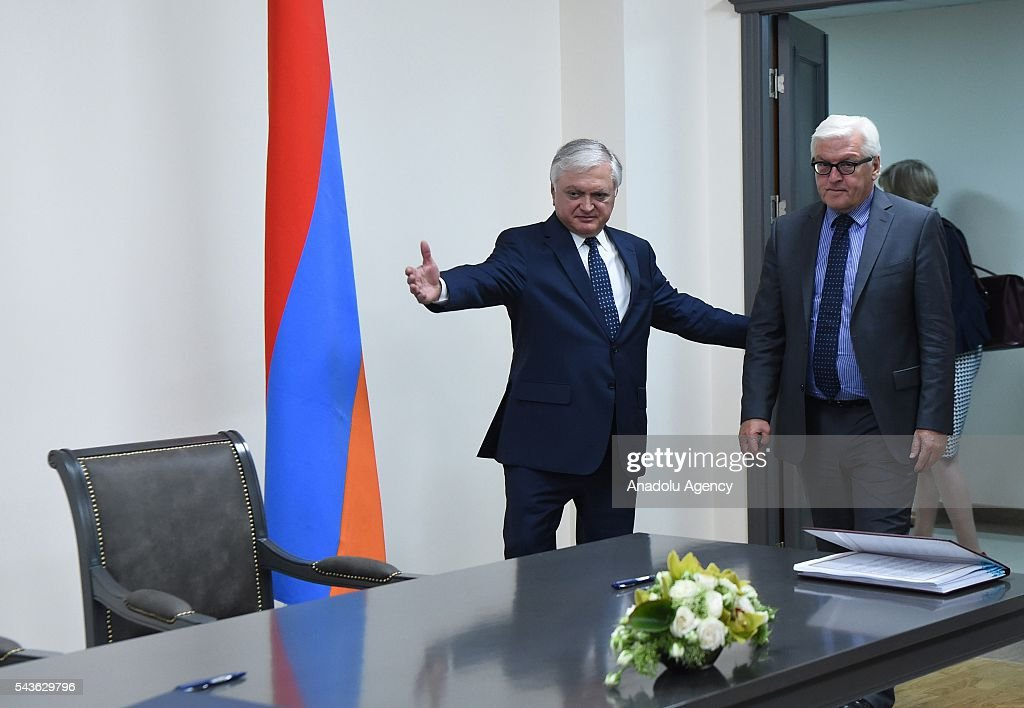 German Foreign Minister Frank-Walter Steinmeier, who currently chairs the Organisation for Security and Cooperation in Europe (OSCE) (R) and Armenian Foreign Minister Edward Nalbandian (R) sign an agreement on double taxation in Yerevan on June 29, 2016