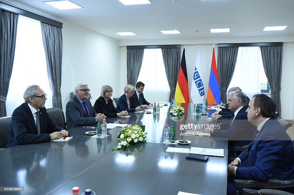 German Foreign Minister Frank-Walter Steinmeier, who currently chairs the Organisation for Security and Cooperation in Europe (OSCE) (2nd L) and Armenian Foreign Minister Edward Nalbandian (2nd R) attend a meeting in Yerevan on June 29, 2016