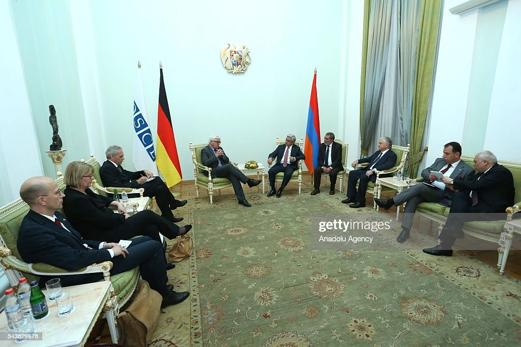 German Foreign Minister Frank-Walter Steinmeier, who currently chairs the Organisation for Security and Cooperation in Europe (OSCE) (C-L) and Armenian Foreign Minister Edward Nalbandian (C-R) attend a meeting in Yerevan on June 29, 2016