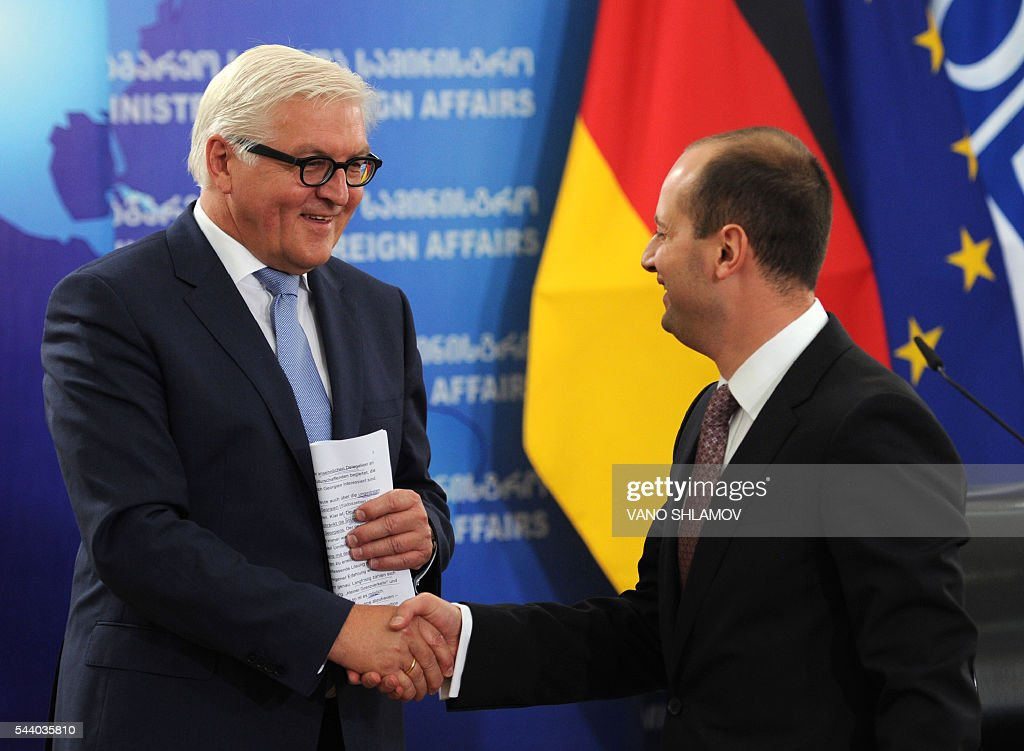 German Foreign Minister Frank-Walter Steinmeier (L), who currently chairs the Organisation for Security and Cooperation in Europe (OSCE) monitoring body, shakes hands with his Georgian counterpart Mikheil Janelidze during their meeting in Tbilisi on July 1, 2016. SHLAMOV