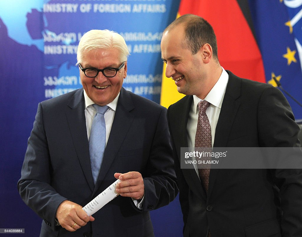 German Foreign Minister Frank-Walter Steinmeier (L), who currently chairs the Organisation for Security and Cooperation in Europe (OSCE) monitoring body, speaks with his Georgian counterpart Mikheil Janelidze during their meeting in Tbilisi on July 1, 2016. SHLAMOV