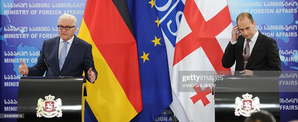 German Foreign Minister Frank-Walter Steinmeier (L), who currently chairs the Organisation for Security and Cooperation in Europe (OSCE) monitoring body, and his Georgian counterpart Mikheil Janelidze attend a news conference in Tbilisi on July 1, 2016. / AFP / Vano Shlamov