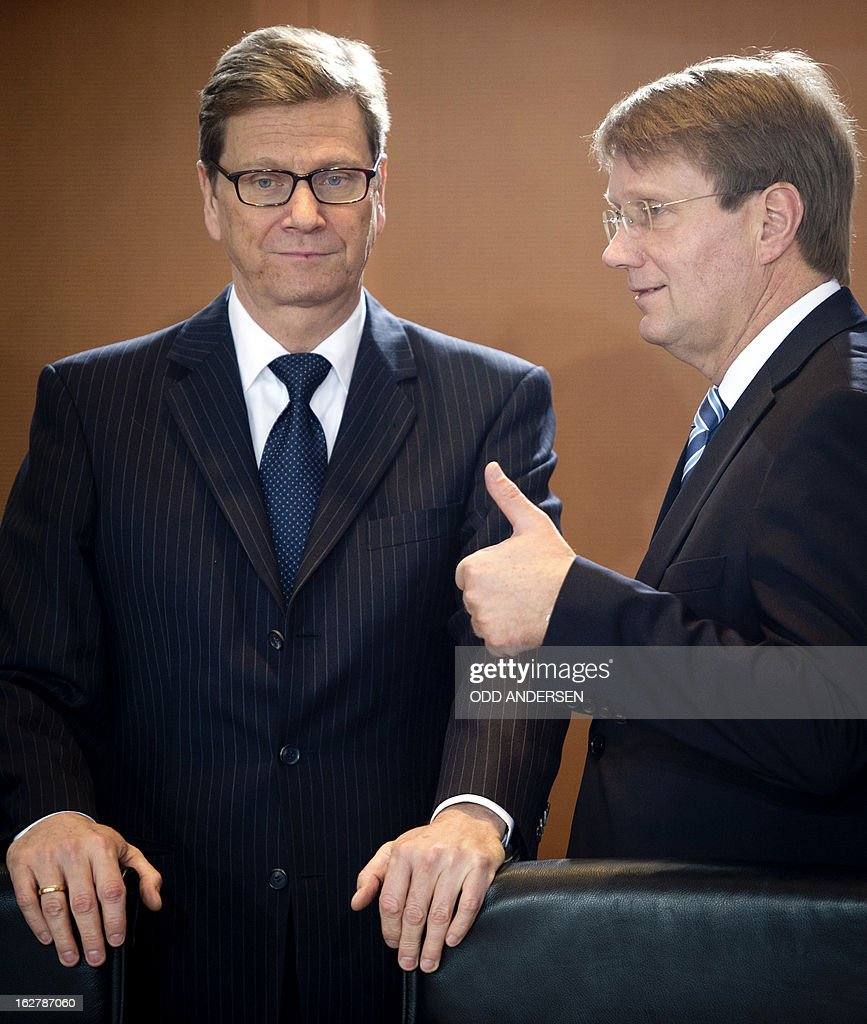German Foreign Minister Guido Westerwelle (L) and Chief of Staff Ronald Pofalla (R) talk ahead of the weekly cabinet meeting at the Chancellery in Berlin, Germany on February 27, 2013.