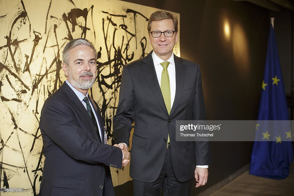 German Foreign Minister <a gi-track='captionPersonalityLinkClicked' href=/galleries/search?phrase=Guido+Westerwelle&family=editorial&specificpeople=208748 ng-click='$event.stopPropagation()'>Guido Westerwelle</a> (R) and Foreign Minister of Brazil, Antonio Patriota, shake hands before a bilateral meeting on day 2 of the 49th Munich Security Conference at Hotel Bayerischer Hof on February 2, 2013 in Munich, Germany. The Munich Security Conference brings together senior figures from around the world to engage in an intensive debate on current and future security challenges and remains the most important independent forum for the exchange of views by international security policy decision-makers.