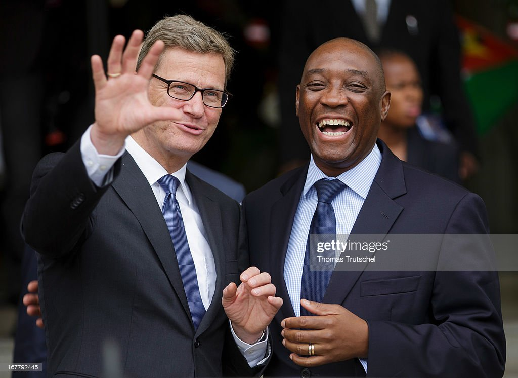 German Foreign Minister <a gi-track='captionPersonalityLinkClicked' href=/galleries/search?phrase=Guido+Westerwelle&family=editorial&specificpeople=208748 ng-click='$event.stopPropagation()'>Guido Westerwelle</a> and Foreign Minister of Mozambique, Oldemiro Baloi, share a light moment after their meeting on April 30, 2013 in Maputo, Mozambique. Westerwelle is on a four-day trip to Africa with stops in Ghana, South Africa and Mozambique.