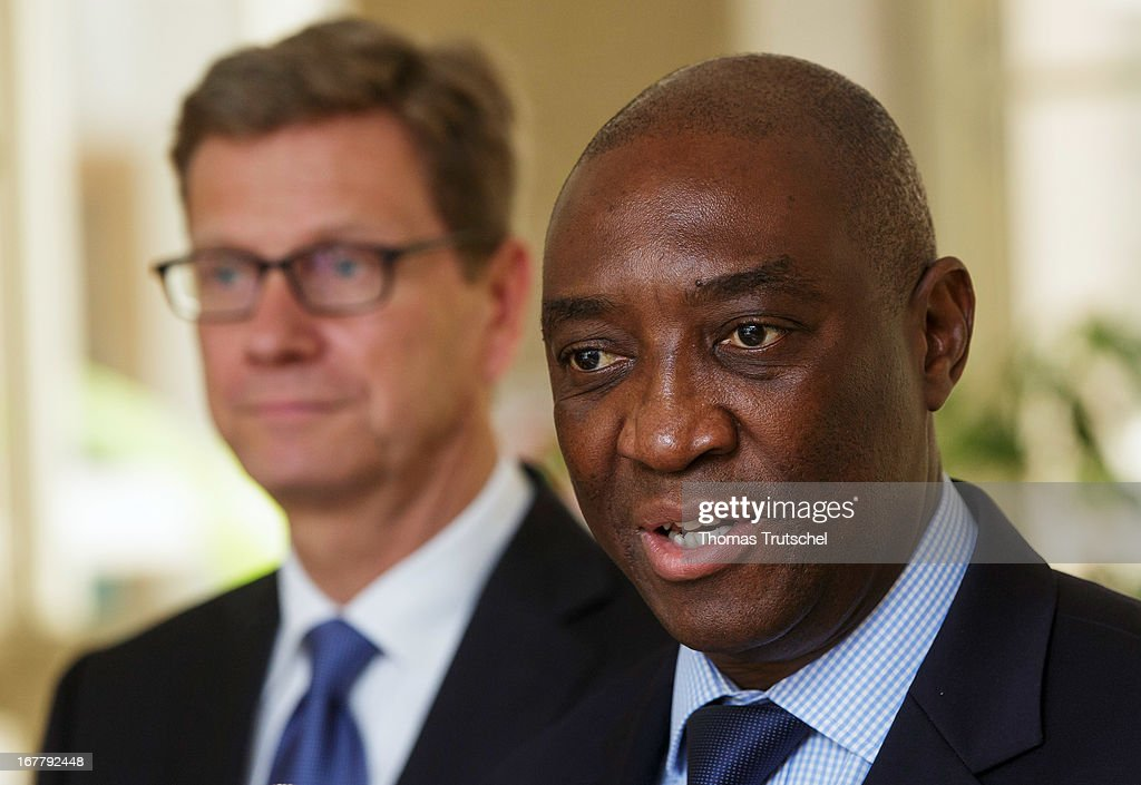 German Foreign Minister Guido Westerwelle and Foreign Minister of Mozambique, Oldemiro Baloi, speak to the press after their meeting on April 30, 2013 in Maputo, Mozambique. Westerwelle is on a four-day trip to Africa with stops in Ghana, South Africa and Mozambique.