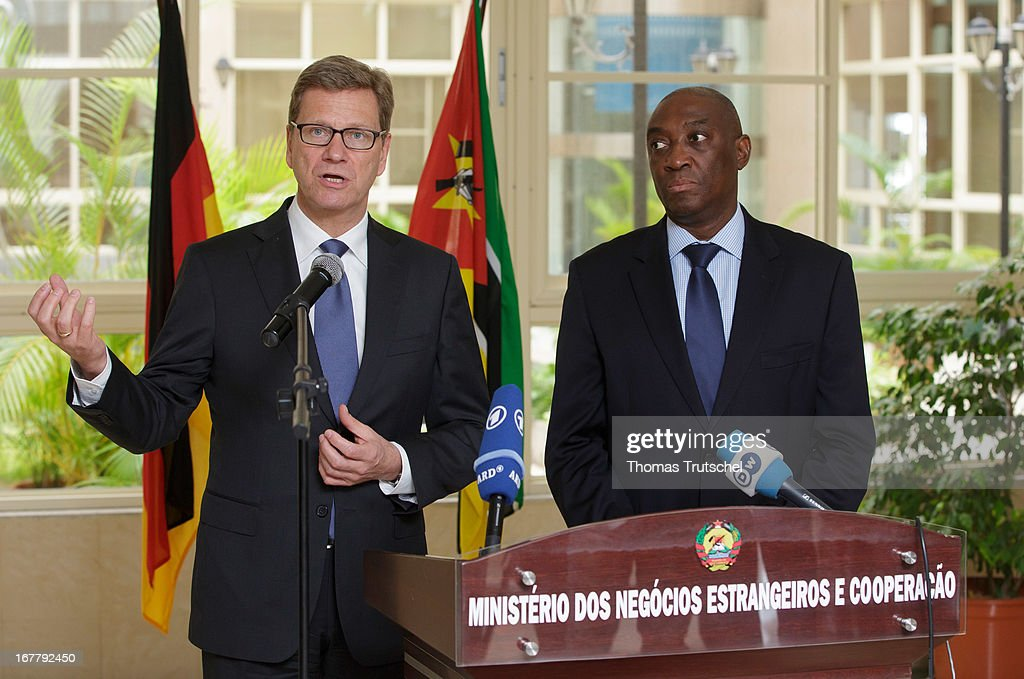 German Foreign Minister <a gi-track='captionPersonalityLinkClicked' href=/galleries/search?phrase=Guido+Westerwelle&family=editorial&specificpeople=208748 ng-click='$event.stopPropagation()'>Guido Westerwelle</a> and Foreign Minister of Mozambique, Oldemiro Baloi, speak to the press after their meeting on April 30, 2013 in Maputo, Mozambique. Westerwelle is on a four-day trip to Africa with stops in Ghana, South Africa and Mozambique.