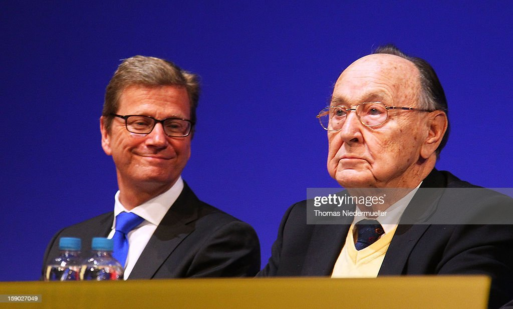German Foreign Minister Guido Westerwelle (L) and former German Foreign Minister Hans-Dietrich Genscher (R) attend the annual Epiphany conference at the state opera house on January 6, 2013 in Stuttgart, Germany.