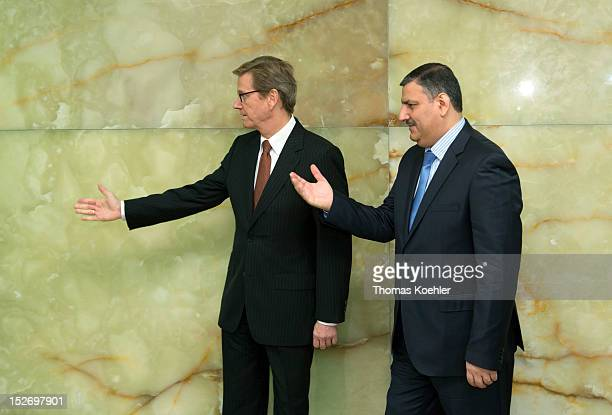 German Foreign Minister Guido Westerwelle and former Syrian Prime Minister Riad Hijab gesture prior a meeting at The Federal Foreign Office on...