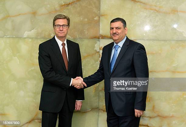 German Foreign Minister Guido Westerwelle and former Syrian Prime Minister Riad Hijab shake hands prior a meeting at The Federal Foreign Office on...