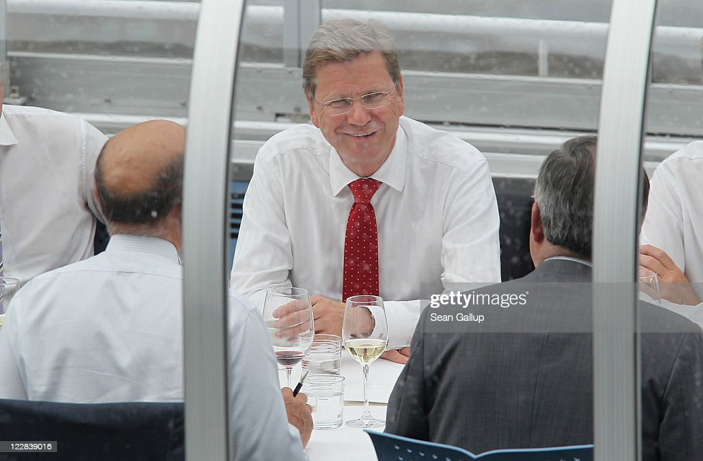 German Foreign Minister <a gi-track='captionPersonalityLinkClicked' href=/galleries/search?phrase=Guido+Westerwelle&family=editorial&specificpeople=208748 ng-click='$event.stopPropagation()'>Guido Westerwelle</a> (C) and French Foreign Minister Alain Juppe (L) hold talks on a boat on the Spree river on August 29, 2011 in Berlin, Germany. The two men discussed stability of the Euro and the current situation in Libya, among other matters. Westerwelle is currently under increasing pressure from ranks within his own party, the German Free Democrats (FDP), many of whom see him as a liability following Westerwelle's reluctance to acknowledge the role of NATO in helping the rebels in Libya defeat forces loyal to Moamer Gaddafi.