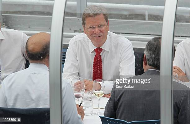German Foreign Minister Guido Westerwelle and French Foreign Minister Alain Juppe hold talks on a boat on the Spree river on August 29 2011 in Berlin...