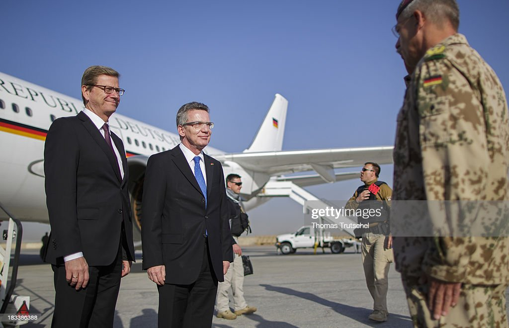German Foreign Minister Guido Westerwelle (L) and German Defence Minister Thomas de Maiziere leave a plane from German Airforce at Mazar-i Sharif Airport on October 06, 2013 in Mazar-i Sharif, Afghansitan. Westerwelle and de Maiziere visit Afghanistan to hand over German PRT in Kunduz to the Afghan Military.