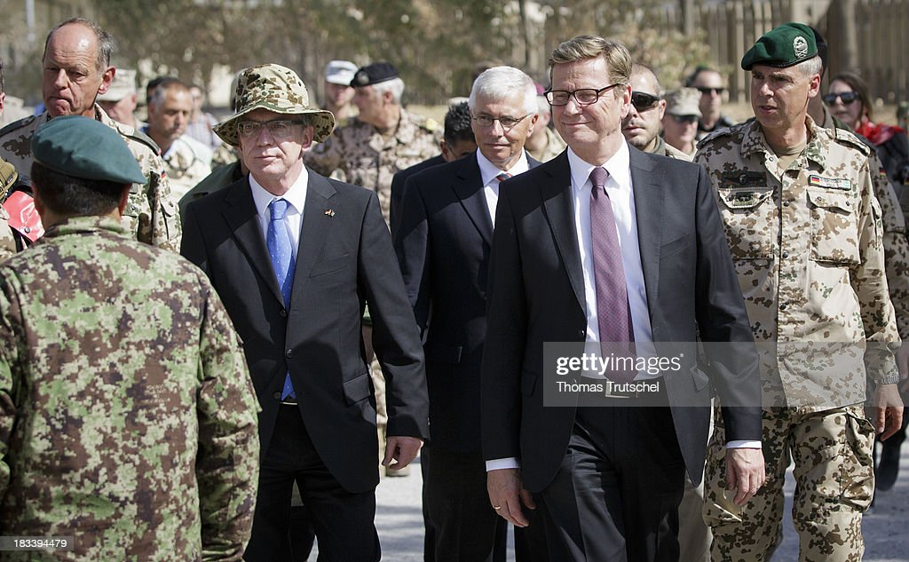 German Foreign Minister Guido Westerwelle (R) and German Defence Minister Thomas de Maiziere are pictured at PRT Kunduz on October 06, 2013 in Kunduz, Afghansitan. Westerwelle and de Maiziere visit Afghanistan to hand over German PRT in Kunduz to the Afghan Military.