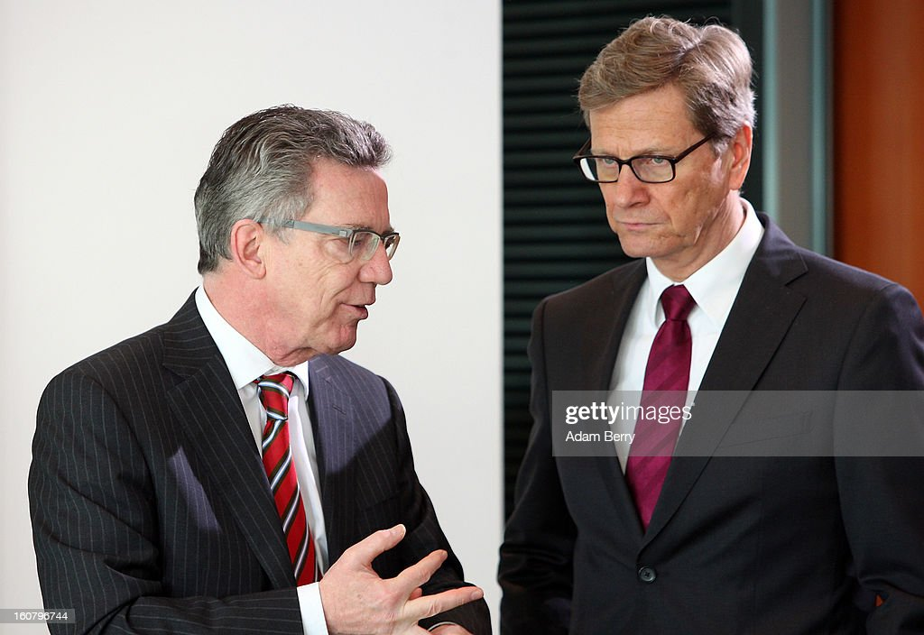 German Foreign Minister <a gi-track='captionPersonalityLinkClicked' href=/galleries/search?phrase=Guido+Westerwelle&family=editorial&specificpeople=208748 ng-click='$event.stopPropagation()'>Guido Westerwelle</a> (R) and German Defense Minister <a gi-track='captionPersonalityLinkClicked' href=/galleries/search?phrase=Thomas+de+Maiziere&family=editorial&specificpeople=618845 ng-click='$event.stopPropagation()'>Thomas de Maiziere</a> arrive for the weekly German government cabinet meeting on February 6, 2013 in Berlin, Germany. High on the morning's agenda was discussion of regulation of financial markets as well as that of credit institutes.