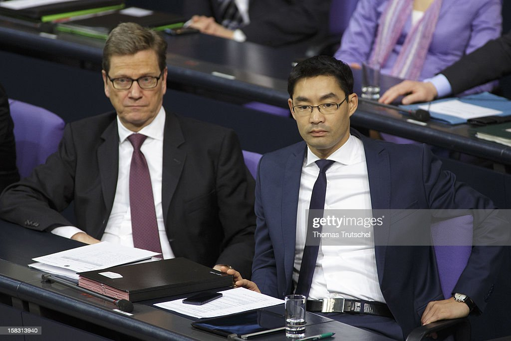 German Foreign Minister <a gi-track='captionPersonalityLinkClicked' href=/galleries/search?phrase=Guido+Westerwelle&family=editorial&specificpeople=208748 ng-click='$event.stopPropagation()'>Guido Westerwelle</a> (L) and German Economy Minister and Vice Chancellor <a gi-track='captionPersonalityLinkClicked' href=/galleries/search?phrase=Philipp+Roesler&family=editorial&specificpeople=4838791 ng-click='$event.stopPropagation()'>Philipp Roesler</a> are pictured at Reichstag, the seat of the German Parliament (Bundestag) on December 13, 2012 in Berlin, Germany.
