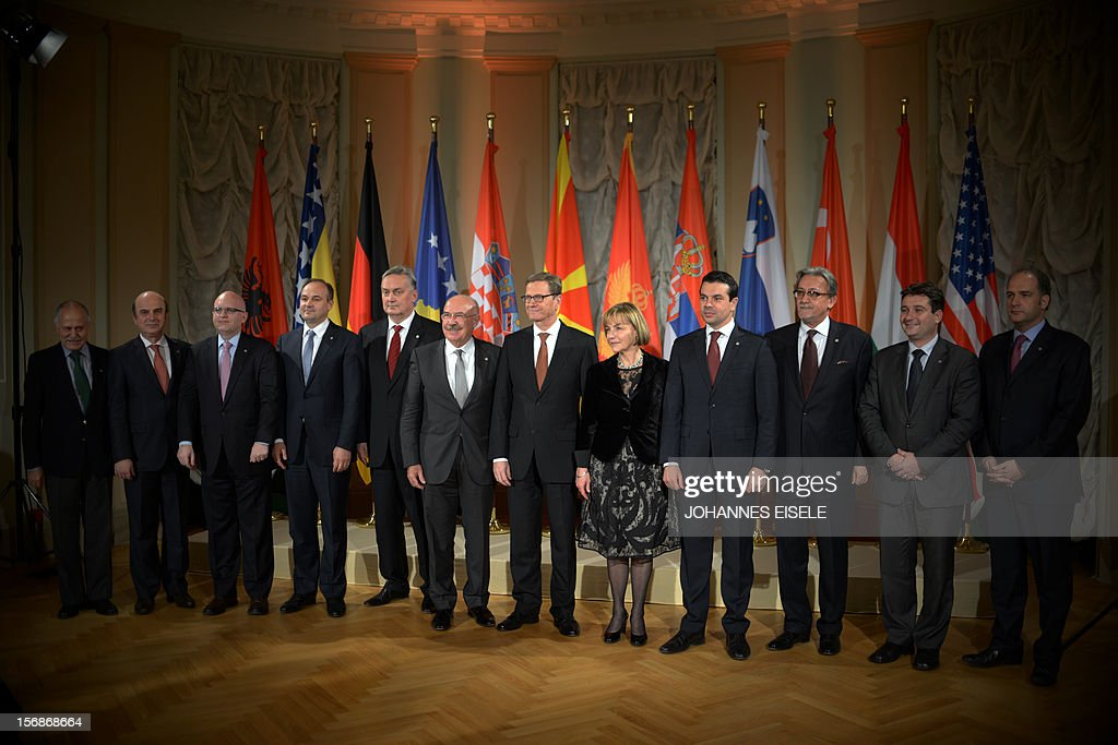 German Foreign Minister Guido Westerwelle (C) and his guests pose for a family picture at the foreign ministry's guesthouse Villa Borsig outside Berlin on November 22, 2012. Westerwelle met some of his eastern European counterparts for dinner.