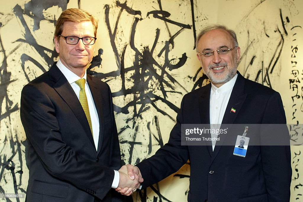 German Foreign Minister <a gi-track='captionPersonalityLinkClicked' href=/galleries/search?phrase=Guido+Westerwelle&family=editorial&specificpeople=208748 ng-click='$event.stopPropagation()'>Guido Westerwelle</a> (L) and Iranian Foreign Minister Ali Akbar Salehi shake hands before a bilateral meeting on day 2 of the 49th Munich Security Conference at Hotel Bayerischer Hof on February 2, 2013 in Munich, Germany. The Munich Security Conference brings together senior figures from around the world to engage in an intensive debate on current and future security challenges and remains the most important independent forum for the exchange of views by international security policy decision-makers.