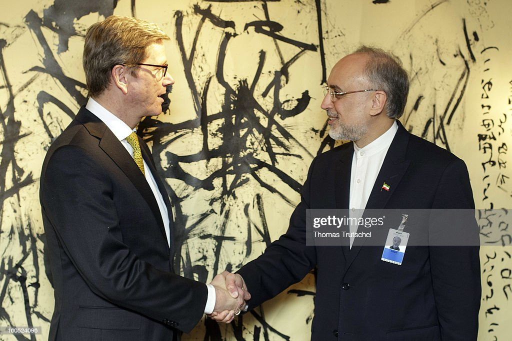 German Foreign Minister <a gi-track='captionPersonalityLinkClicked' href=/galleries/search?phrase=Guido+Westerwelle&family=editorial&specificpeople=208748 ng-click='$event.stopPropagation()'>Guido Westerwelle</a> (L) and Iranian Foreign Minister Ali Akbar Salehi shakes hands before a bilateral meeting on day 2 of the 49th Munich Security Conference at Hotel Bayerischer Hof on February 2, 2013 in Munich, Germany. The Munich Security Conference brings together senior figures from around the world to engage in an intensive debate on current and future security challenges and remains the most important independent forum for the exchange of views by international security policy decision-makers.