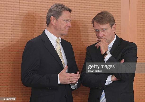 German Foreign Minister Guido Westerwelle and Minister of the Chancellery Ronald Pofalla arrive for the weekly German government cabinet meeting on...