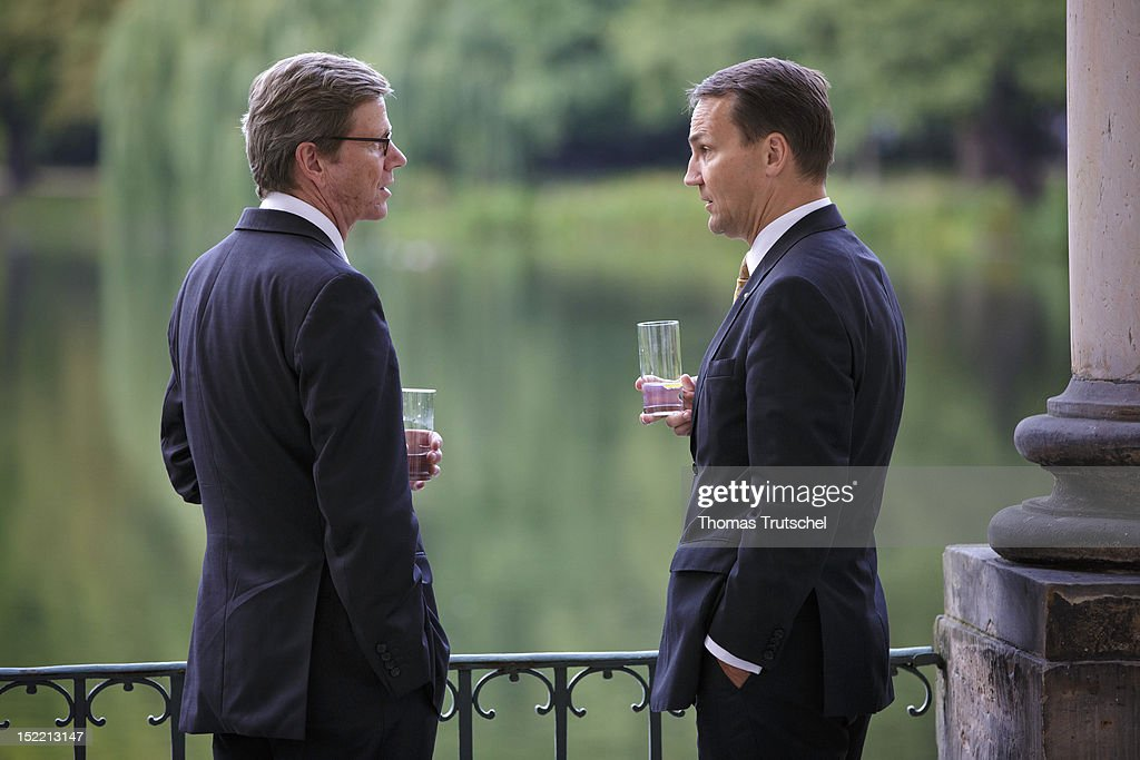 German Foreign Minister <a gi-track='captionPersonalityLinkClicked' href=/galleries/search?phrase=Guido+Westerwelle&family=editorial&specificpeople=208748 ng-click='$event.stopPropagation()'>Guido Westerwelle</a> (L), and <a gi-track='captionPersonalityLinkClicked' href=/galleries/search?phrase=Radoslaw+Sikorski&family=editorial&specificpeople=736409 ng-click='$event.stopPropagation()'>Radoslaw Sikorski</a>, Foreign Minister of Poland speak during a last meeting of 'Future of Europe' group of European Foreign Affairs Minister on September 17, 2012 in Warsaw, Poland. German Foreign Affairs Minister <a gi-track='captionPersonalityLinkClicked' href=/galleries/search?phrase=Guido+Westerwelle&family=editorial&specificpeople=208748 ng-click='$event.stopPropagation()'>Guido Westerwelle</a> and ten of his EU counterparts met to produce a final report summing up the input given by the eleven ministers. The 'Future of Europe' group's first meeting took place in March in Berlin, Germany, upon the initiative of Westerwelle. Since then, meetings have been held in Brussels, Vienna and Majorca.