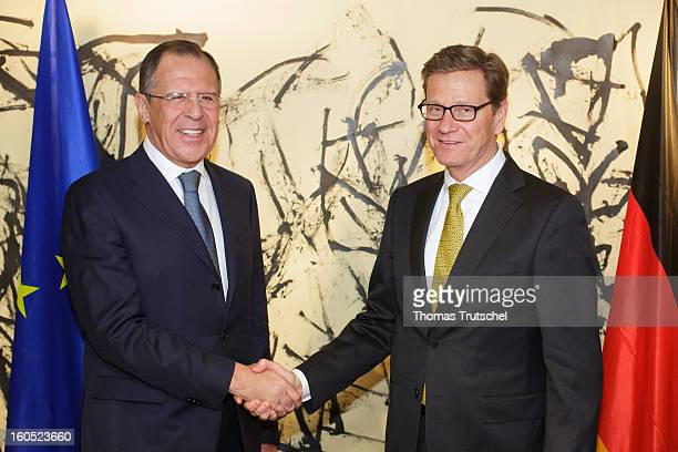 German Foreign Minister Guido Westerwelle and Russia's Foreign Minister Sergey Lavrov shake hands before their bilateral meeting on day 2 of the 49th...
