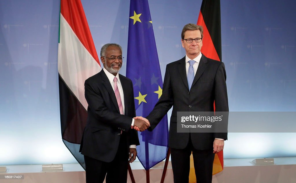 German Foreign Minister <a gi-track='captionPersonalityLinkClicked' href=/galleries/search?phrase=Guido+Westerwelle&family=editorial&specificpeople=208748 ng-click='$event.stopPropagation()'>Guido Westerwelle</a> (R) and Sudanese Foreign Minister Ali Karti (L) pose for a picture during a bilateral meeting at the Federal Foreign Office on January 29, 2013 in Berlin, Germany. Their talks will focus on the peace process between Sudan and South Sudan.