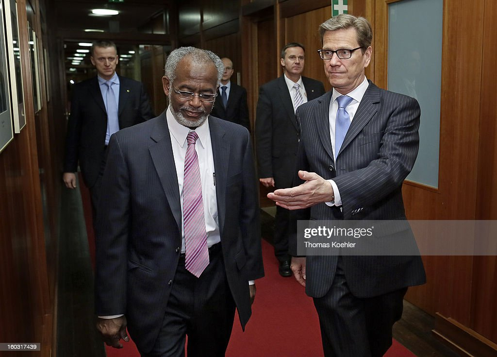 German Foreign Minister <a gi-track='captionPersonalityLinkClicked' href=/galleries/search?phrase=Guido+Westerwelle&family=editorial&specificpeople=208748 ng-click='$event.stopPropagation()'>Guido Westerwelle</a> (R) and Sudanese Foreign Minister Ali Karti (L) are seen before a trilateral meeting at the Federal Foreign Office on January 29, 2013 in Berlin, Germany. Their talks will focus on the peace process between Sudan and South Sudan.