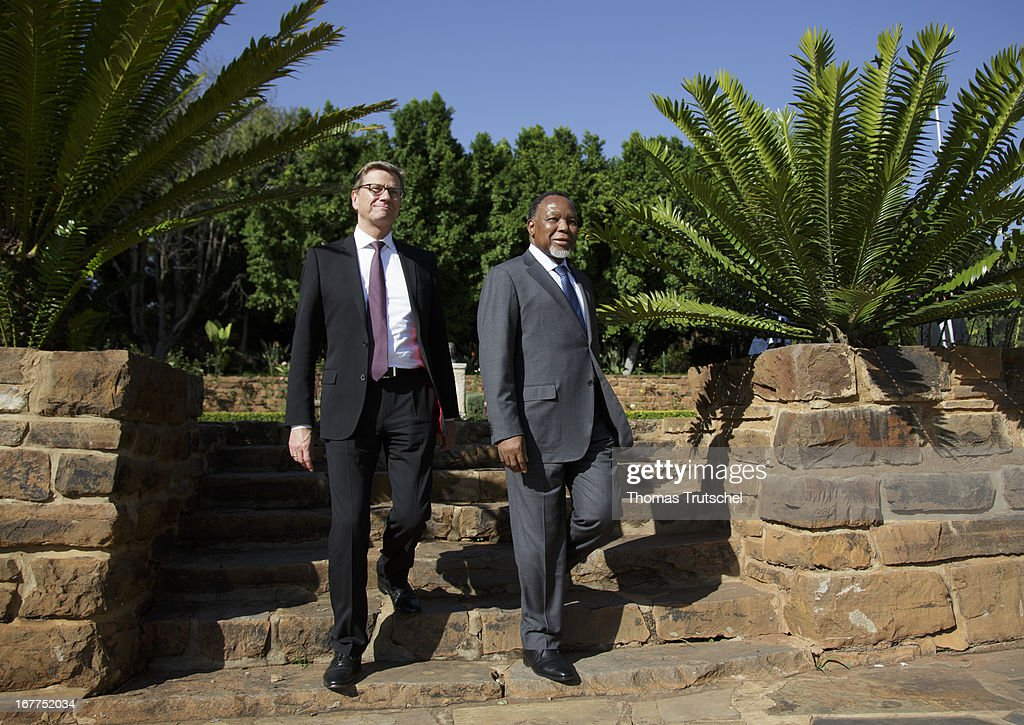German Foreign Minister Guido Westerwelle (L) and Vice President of South Africa, Kgalema Motlanthe are pictured in vice president's garden on April 29, 2013 in Pretoria, South Africa. Westerwelle is on a four day trip to Africa with stops in Ghana, South Africa and Mozambique.