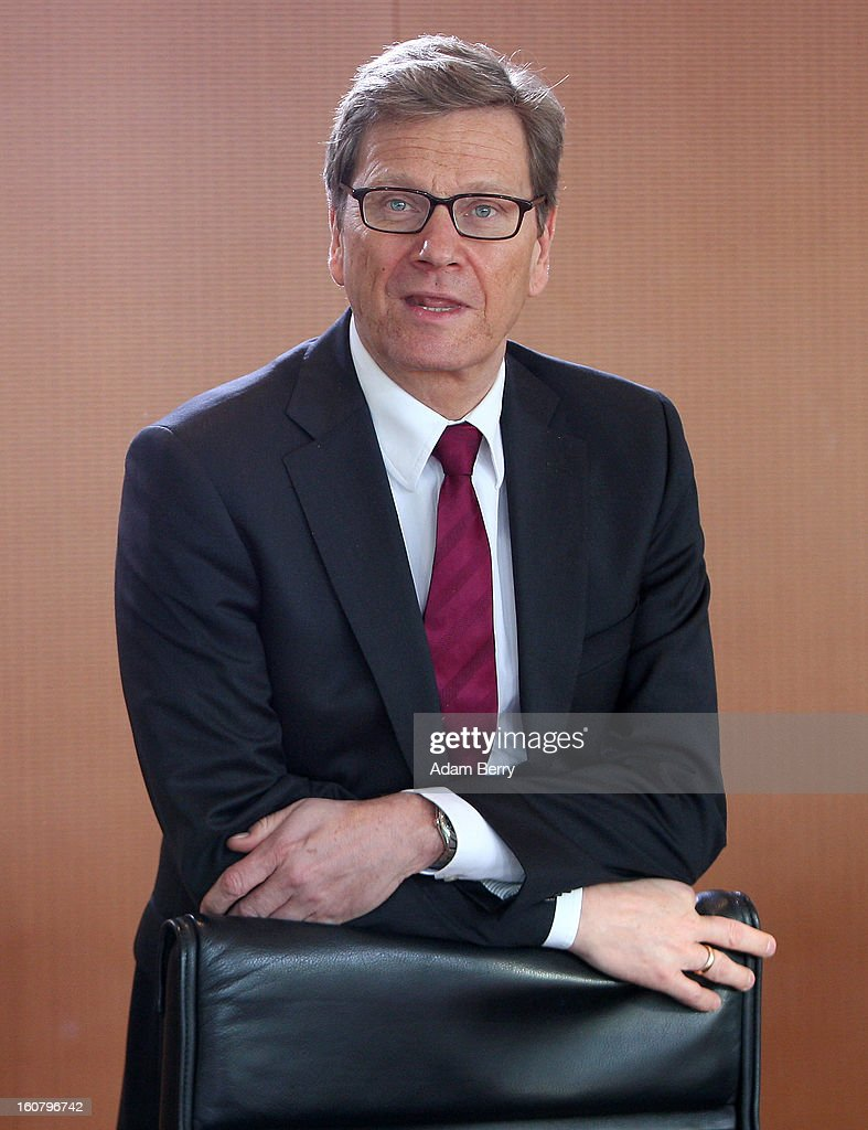 German Foreign Minister <a gi-track='captionPersonalityLinkClicked' href=/galleries/search?phrase=Guido+Westerwelle&family=editorial&specificpeople=208748 ng-click='$event.stopPropagation()'>Guido Westerwelle</a> arrives for the weekly German government cabinet meeting on February 6, 2013 in Berlin, Germany. High on the morning's agenda was discussion of regulation of financial markets as well as that of credit institutes.