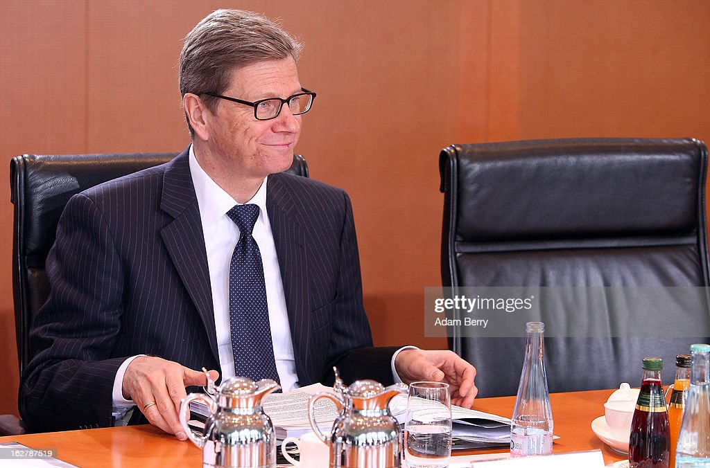 German Foreign Minister <a gi-track='captionPersonalityLinkClicked' href=/galleries/search?phrase=Guido+Westerwelle&family=editorial&specificpeople=208748 ng-click='$event.stopPropagation()'>Guido Westerwelle</a> arrives for the weekly German federal cabinet meeting on February 27, 2013 in Berlin, Germany. High on the morning's agenda was discussion of the country's annual report on disarmament as well as of potential modifications to a law on employment rights for foreigners.