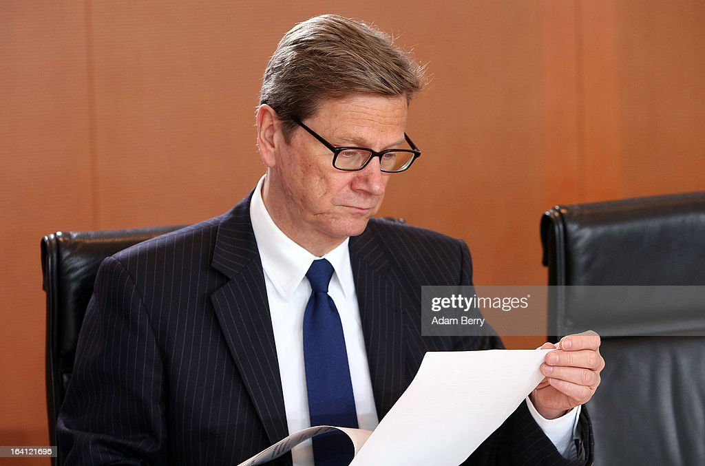 German Foreign Minister <a gi-track='captionPersonalityLinkClicked' href=/galleries/search?phrase=Guido+Westerwelle&family=editorial&specificpeople=208748 ng-click='$event.stopPropagation()'>Guido Westerwelle</a> attends the German federal Cabinet meeting on March 20, 2013 in Berlin, Germany. High on the morning's agenda was discussion of proposed laws pertaining to preventative health measures as well as the proposed ban on the right-wing National Democratic Party (Nationaldemokratische Partei Deutschlands, or NPD), which, contrary to a joint bid by Germany's 16 states, the federal government has not supported.