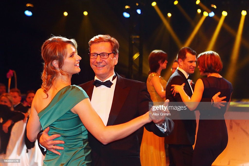 German Foreign Minister <a gi-track='captionPersonalityLinkClicked' href=/galleries/search?phrase=Guido+Westerwelle&family=editorial&specificpeople=208748 ng-click='$event.stopPropagation()'>Guido Westerwelle</a> dances with <a gi-track='captionPersonalityLinkClicked' href=/galleries/search?phrase=Britta+Heidemann&family=editorial&specificpeople=2206865 ng-click='$event.stopPropagation()'>Britta Heidemann</a> during the 'Ball des Sports 2013' at Rhein-Main-Hallen on February 2, 2013 in Wiesbaden, Germany.
