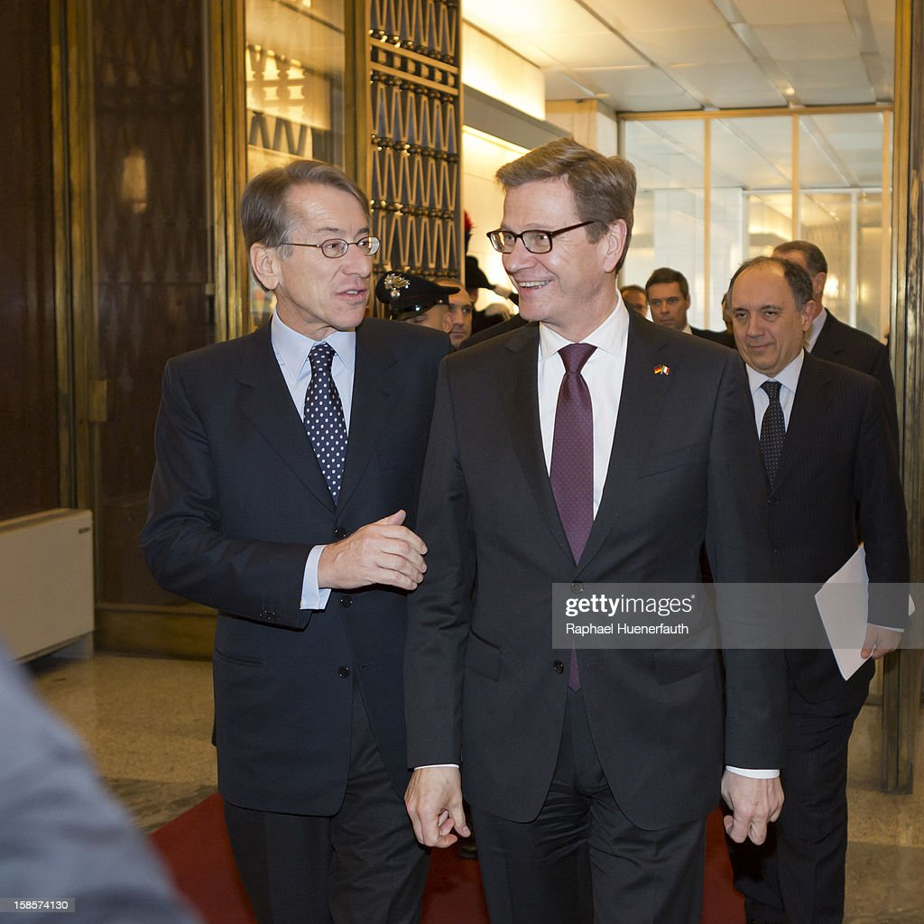 German Foreign Minister <a gi-track='captionPersonalityLinkClicked' href=/galleries/search?phrase=Guido+Westerwelle&family=editorial&specificpeople=208748 ng-click='$event.stopPropagation()'>Guido Westerwelle</a> (R), FDP, and his Italian counterpart Giulio Terzi di Sant'Agata (L) arrive at the Italian Foreign Ministry on December 19, 2012 in Rome, Italy. Westerwelle met Terzi for the handover of the final report of the German-Italian historical commission.