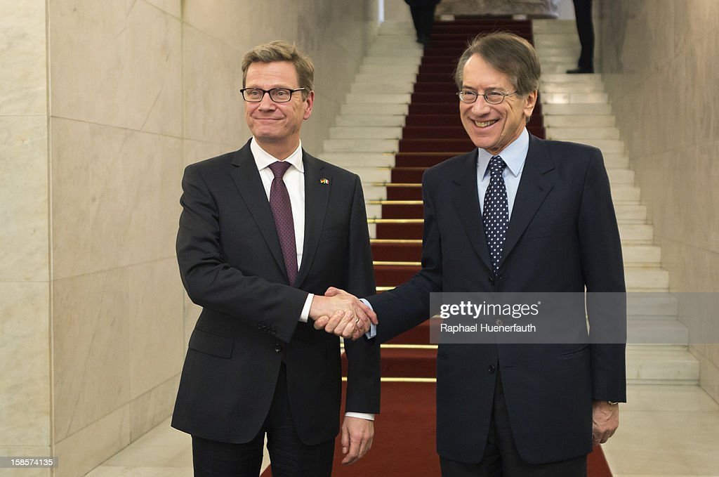 German Foreign Minister <a gi-track='captionPersonalityLinkClicked' href=/galleries/search?phrase=Guido+Westerwelle&family=editorial&specificpeople=208748 ng-click='$event.stopPropagation()'>Guido Westerwelle</a> (L), FDP, shakes hands with his Italian counterpart Giulio Terzi di Sant'Agata (R) after the presentation of the report on December 19, 2012 in Rome, Italy. Westerwelle meets Terzi for the handover of the final report of the German-Italian historical commission.