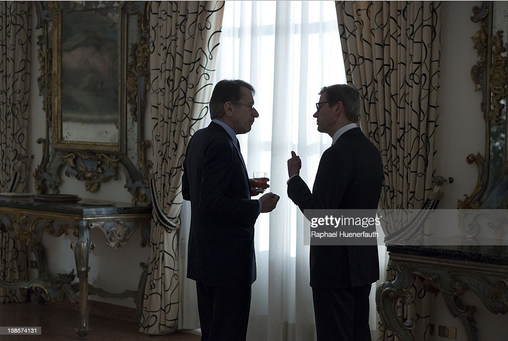 German Foreign Minister <a gi-track='captionPersonalityLinkClicked' href=/galleries/search?phrase=Guido+Westerwelle&family=editorial&specificpeople=208748 ng-click='$event.stopPropagation()'>Guido Westerwelle</a> (R), FDP, talkes with his Italian counterpart Giulio Terzi di Sant'Agata (L) at the Palazzo della Farnesina after the presentation of the report on December 19, 2012 in Rome, Italy. Westerwelle meets Terzi for the handover of the final report of the German-Italian historic commission.