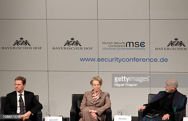 German Foreign Minister Guido Westerwelle French Foreign Minister Michele AlliotMarie and Afghan President Hamid Karzai sit on the podium during the...