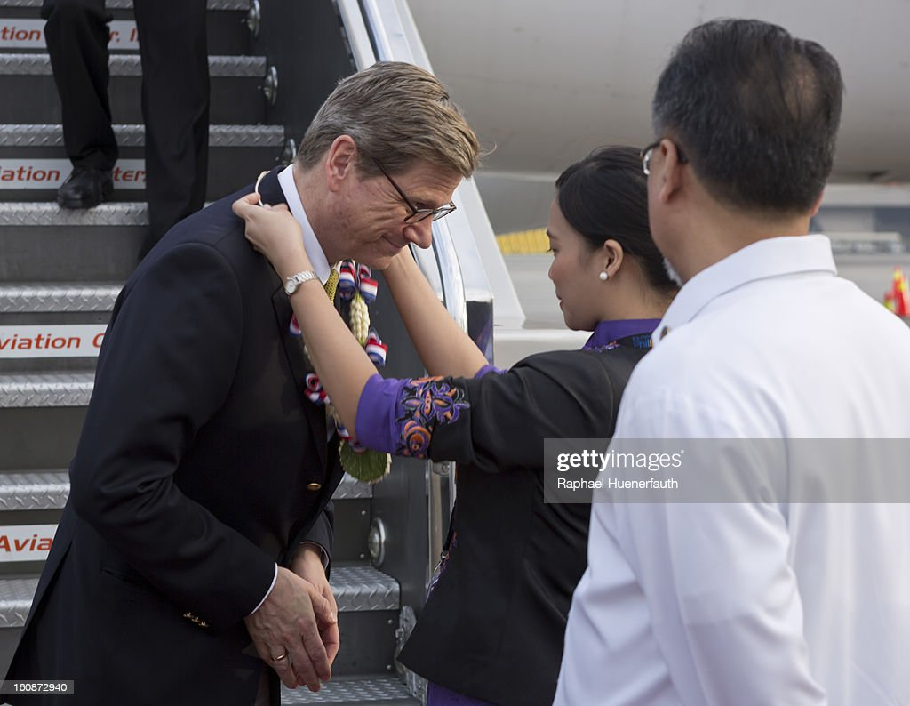 German Foreign Minister Guido Westerwelle gets floral wreaths, when he arrives at the Ninoy Aquinto International Airport on February 7, 2013 in Manila, Philippines. Westerwelle, who is the first German Foreign Minister to visit the Philippines in more than twelve years, is in Manila to discuss bilateral trade and relations accompanied by a 12-man business delegation.