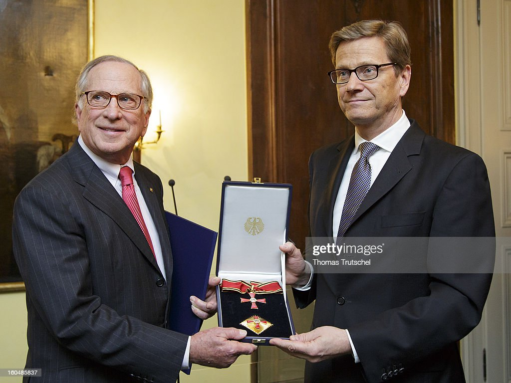 German Foreign Minister <a gi-track='captionPersonalityLinkClicked' href=/galleries/search?phrase=Guido+Westerwelle&family=editorial&specificpeople=208748 ng-click='$event.stopPropagation()'>Guido Westerwelle</a> (R) gives an award to U.S. Senator <a gi-track='captionPersonalityLinkClicked' href=/galleries/search?phrase=Sam+Nunn&family=editorial&specificpeople=209203 ng-click='$event.stopPropagation()'>Sam Nunn</a> on day 1 of the 49th Munich Security Conference at Hotel Bayerischer Hof on February 1, 2013 in Munich, Germany. The Munich Security Conference brings together senior figures from around the world to engage in an intensive debate on current and future security challenges and remains the most important independent forum for the exchange of views by international security policy decision-makers.