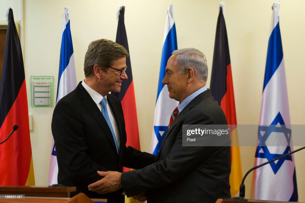 German Foreign Minister <a gi-track='captionPersonalityLinkClicked' href=/galleries/search?phrase=Guido+Westerwelle&family=editorial&specificpeople=208748 ng-click='$event.stopPropagation()'>Guido Westerwelle</a> (L) is greeted by Israel's Prime Minister <a gi-track='captionPersonalityLinkClicked' href=/galleries/search?phrase=Benjamin+Netanyahu&family=editorial&specificpeople=118594 ng-click='$event.stopPropagation()'>Benjamin Netanyahu</a> before their meeting on May 17, 2013 in Jerusalem, Israel. Westerwelle is on two-day trip to Israel and the Palestinian territories, aimed at promoting a new start to peace talks.