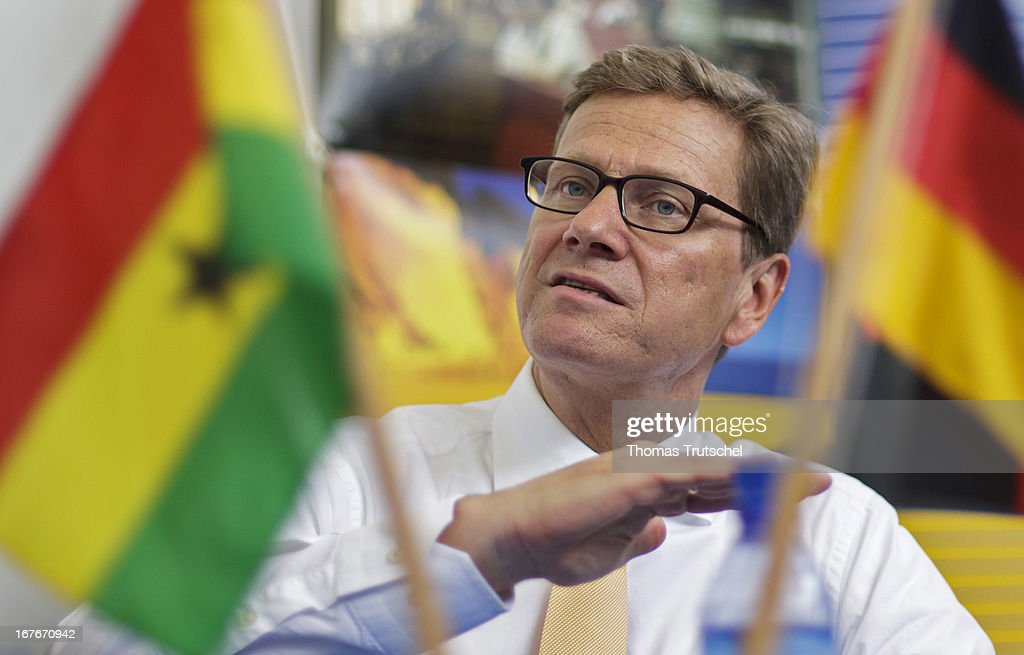 German Foreign Minister <a gi-track='captionPersonalityLinkClicked' href=/galleries/search?phrase=Guido+Westerwelle&family=editorial&specificpeople=208748 ng-click='$event.stopPropagation()'>Guido Westerwelle</a> is pictured during a discussion with students from German Academic Exchange Service (Deutscher Akademischer Austauschdienst - DAAD) on April 27, 2013 in Accra, Ghana. Westerwelle is on a four day trip to Africa with stops in Ghana, South Africa and Mozambique.
