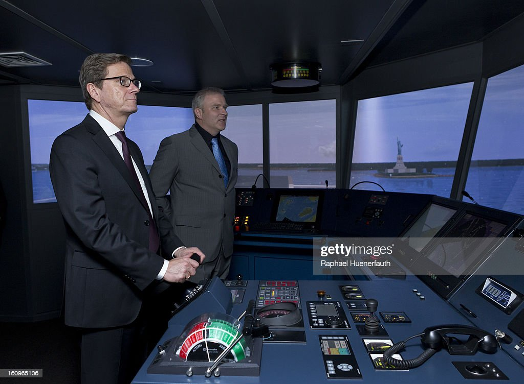 German Foreign Minister Guido Westerwelle (L) is steering a ship in to the port of New York City and Capt Rainer Starke, Vice President ETCC, in the bridge simulator from the European Training and Competence Center (ETCC) Inc. in the Doehle Haus on February 8, 2013 in Manila, Philippines. Westerwelle, who is the first German Foreign Minister to visit the Philippines in more than twelve years, is in Manila to discuss bilateral trade and relations accompanied by a 12-man business delegation.