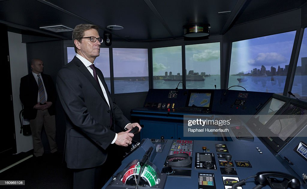 German Foreign Minister Guido Westerwelle is steering a ship in to the port of New York City, in the bridge simulator from the European Training and Competence Center (ETCC) Inc. in the Doehle Haus on February 8, 2013 in Manila, Philippines. Westerwelle, who is the first German Foreign Minister to visit the Philippines in more than twelve years, is in Manila to discuss bilateral trade and relations accompanied by a 12-man business delegation.